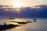 Fishermen at sunset — Stock Photo