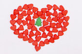 Red heart and green spruce — Stock Photo