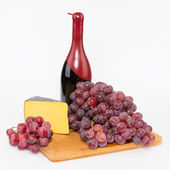 Cheese grapes and red wine — Stock Photo