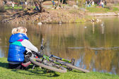 Cyclist in the park pond  — Stock Photo
