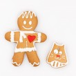 Gingerbread man and a cat — Stock Photo #50621305