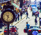 Clock and the city — Stock Photo
