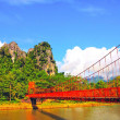 Red bridge cross the river in Vangviang city , the natural place for backpacker in Northern Laos — Stock Photo