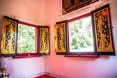 Ancient windows in the Buddhist temple — Stock Photo