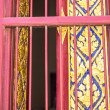 Ancient windows in the Buddhist temple — Stock Photo #37734927