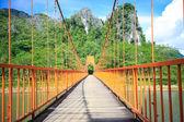 Bridge over song river in Laos — Stock Photo