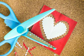 Cutting the heart shaped paper — Foto Stock
