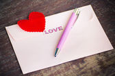 Envelope and pen with heart. — Stock Photo