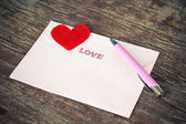 Envelope and pen with heart. — Photo