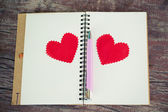 Notebook with heart. Send message to your lover in Valentine's day. — Stock Photo