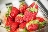 Fresh strawberries in a plastic box — Stock Photo