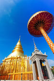 Golden pagoda at War Phra That Hariphunchai temple, Lamphun Thailand. — Photo