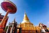 Golden pagoda at War Phra That Hariphunchai temple, Lamphun Thailand. — Stock Photo