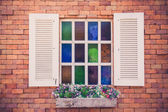 Retro white window on brick — Stock Photo