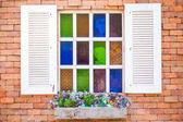 Retro white window on brick — Stockfoto