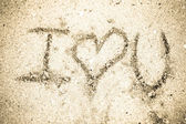 """""""I love you"""" on sand — Stock Photo"""