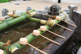 A water well with prayers on bamboo at Hesedera temple — Foto Stock