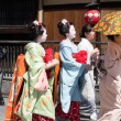 ������, ������: Traditional geishas are walking pass on Gion street in Kyoto on April 15 2014 in Kyoto JAPAN