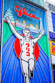 Glico logo neon sign at Shinsaibashi shopping arcade on April 18, 2014 in Osaka, JAPAN. — Stock Photo