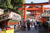 A giant torii gate in front of the Romon Gate at Fushimi Inari Shrine's entrance on April 15, 2014 in Kyoto, Japan. — Stock Photo