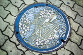 Osaka Castle on manhole cover of Osaka — Stock Photo