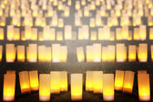 Yellow candles lighting for background — Stock Photo