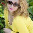 Stock Photo: Portrait of beautiful young womin yellow dress and sunglasses.