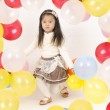 Beautiful little girl playing with colorful balloons . — Stock Photo #41097261