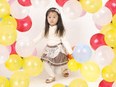 Beautiful little girl playing with colorful balloons . — Stock Photo