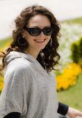 Spring portrait of young beautiful women in dark sunglasses . — Fotografia Stock