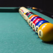Billiard table with colorful balls ranging from game soft focus — Stock Photo #36375529