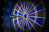 Darts arrows in the center — Stock Photo