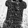 Stock Photo: Small and Dark Headstone from 19th Century