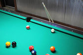 A Game of Pool In Progress with Cues — Stock Photo