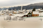 Village in winter in mountains — Stock Photo