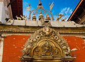 : Fragments of the decoration of the temple of Nepal — Stock Photo