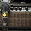 Worn amp and electric guitar — Stock Photo #40602023