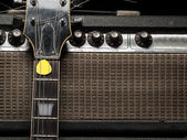 Worn amp and electric guitar — Stock Photo