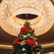 Tall christmas tree with luster — Stock fotografie