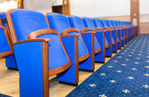 Conference hall with blue seats — ストック写真