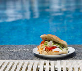 Sandwich near the swimming pool — Stock Photo