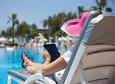 Woman on sunbed — Stok fotoğraf