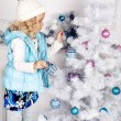 Cute little girl with Christmas tree — ストック写真