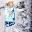 Cute little girl with Christmas tree — Stock Photo