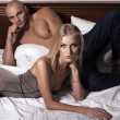 Sexy couple in bedroom — Stock Photo