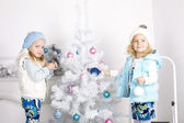 Little girls with Christmas tree — Stock Photo