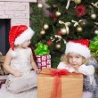 Little girls in Santa's hat — Stock Photo
