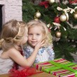 Little girls with Christmas gifts — Stok fotoğraf