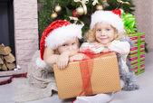 Little girls in Santa's hat — Stock Photo