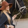 Beautiful girl with black horse — Foto de Stock